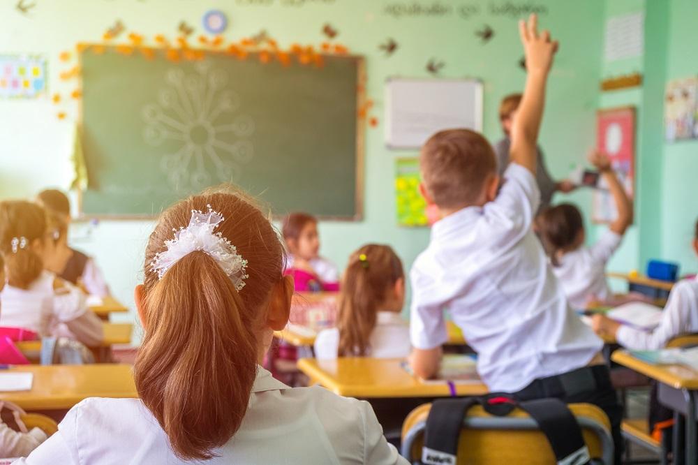 student sitting in class room - GD Goenka signature school